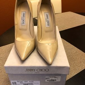 Nude pointy toe Jimmy Choo pumps.